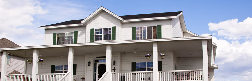 house with siding under blue sky