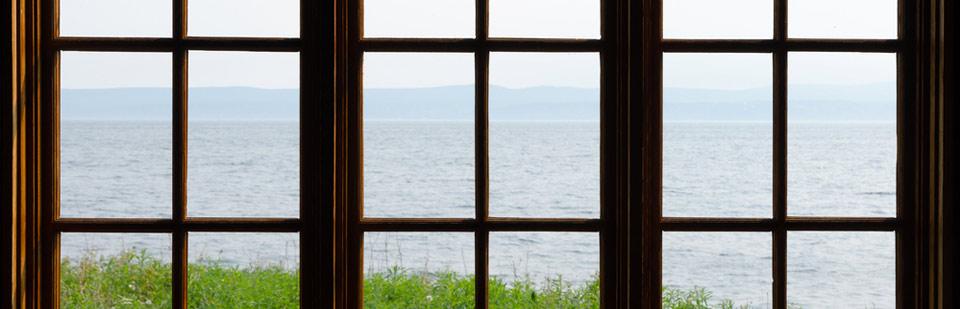 window overlooking a blue ocean