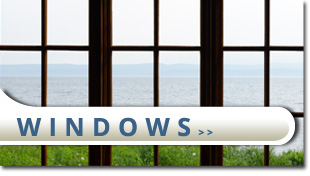 glass window overlooking ocean with a button
